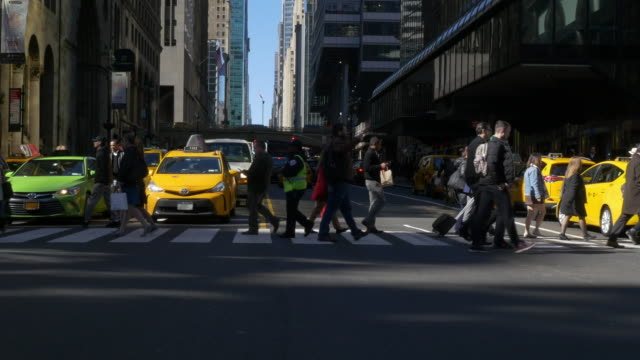slow motion of people walking in nyc - traffic stock videos & royalty-free footage