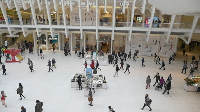 slow motion of people walking in westfield world trade center oculus at rush hour. - shopping centre stock videos & royalty-free footage
