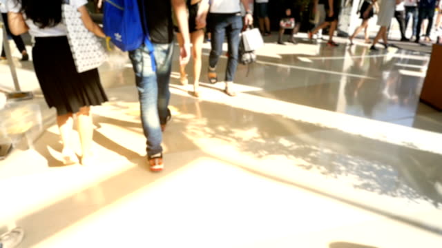 Slow motion of people walking on city