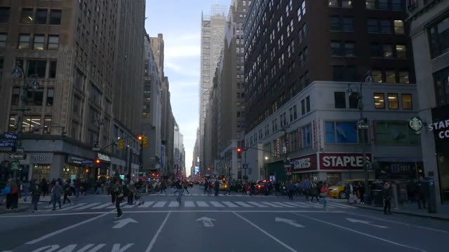 slow motion of people walking on the 8th ave in new york city. - traffic light stock videos & royalty-free footage