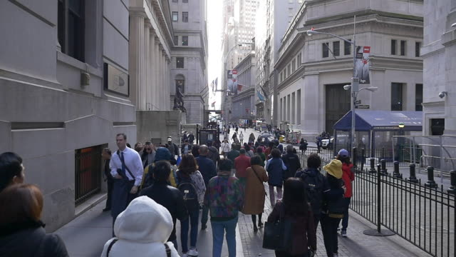 slow motion of people walking on the wall street - mixed race person stock videos & royalty-free footage