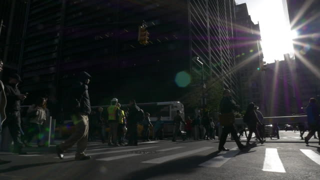 slow motion of people walking under bright sunlight at rush hour in the new york city - light beam stock videos & royalty-free footage