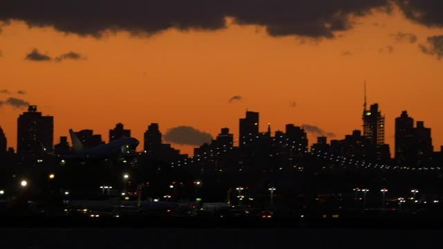 slow motion of plane taking off in laguardia airport in new york city - ハイコントラスト点の映像素材/bロール