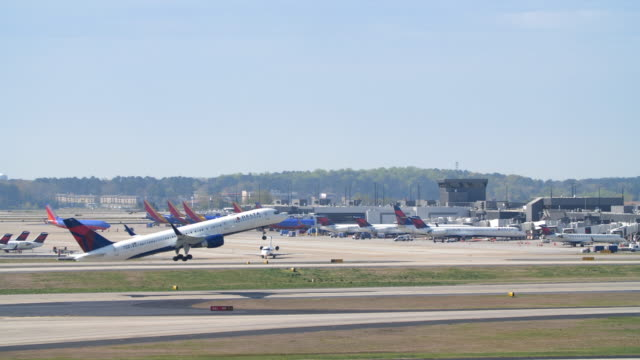 slow motion of plane taxiing and taking off from the atlanta international airport - delta stock videos and b-roll footage