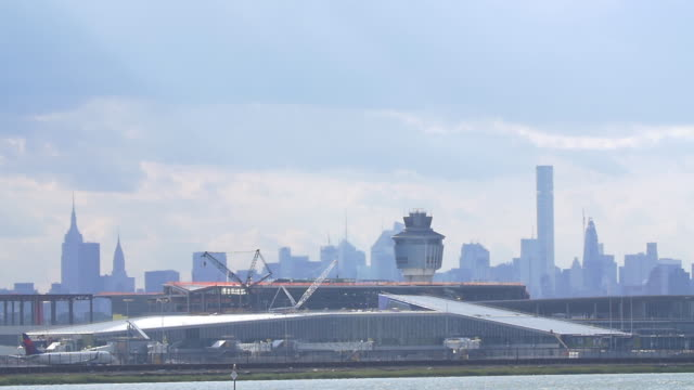 slow motion of plane taxiing in laguardia airport in new york city. - torre di controllo video stock e b–roll