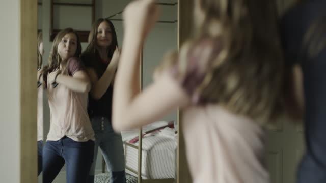 vidéos et rushes de slow motion of playful teenage girls dancing in mirror and shoving each other / cedar hills, utah, united states - soeur