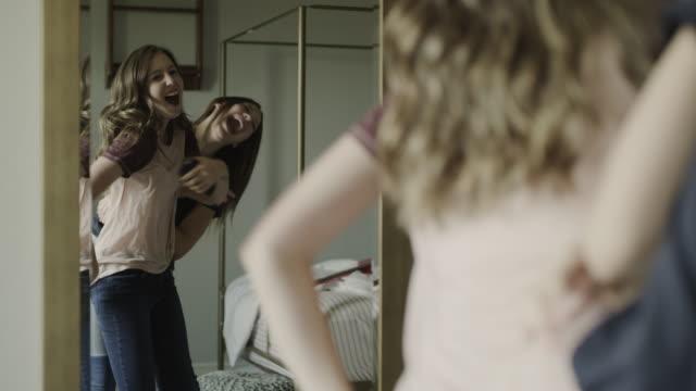 slow motion of playful teenage girls dancing in mirror / cedar hills, utah, united states - bedroom stock videos & royalty-free footage