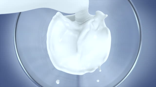 slow motion of pouring milk into glass,top view,close-up - latte video stock e b–roll
