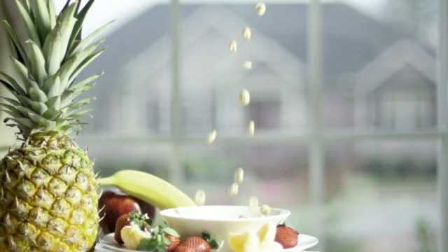 slow motion of preparing breakfast with cereal - slip banana stock videos & royalty-free footage