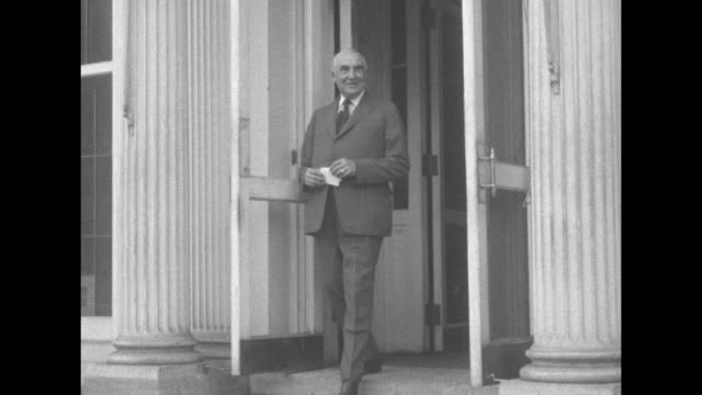 slow motion of pres. warren g. harding exiting through screen doors at the north portico of the white house; close-up - president stock videos & royalty-free footage