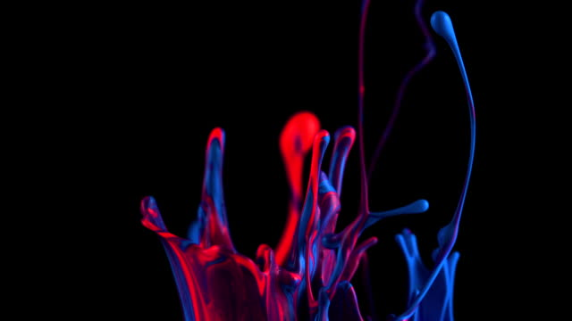 Slow Motion of red and blue paints bouncing and splashing on black background