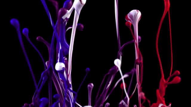slow motion of red, blue and white paints bouncing and splashing on black background - はずむ点の映像素材/bロール