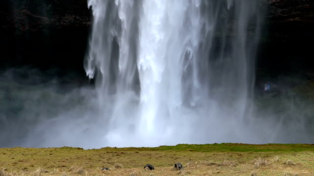 hd slow motion of seljalandsfoss waterfall, iceland, photo-jpg 1920x1080 format - seljalandsfoss waterfall stock videos and b-roll footage