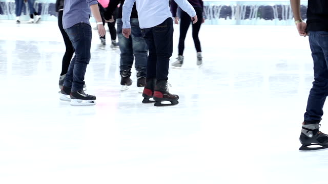 slow motion of skating on artificial ice at bryant park in new york city. - bryant park stock videos and b-roll footage