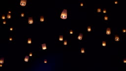 Slow motion of sky lanterns also known as Kongming lantern or Chinese lantern, is a small hot air balloon made of paper