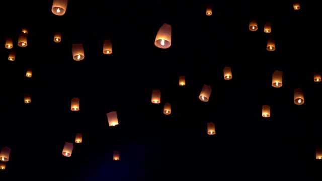 slow motion of sky lanterns also known as kongming lantern or chinese lantern, is a small hot air balloon made of paper - lantern stock videos & royalty-free footage