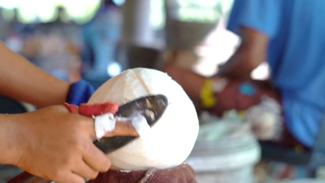 slow motion of slicing coconut - serving size stock videos & royalty-free footage