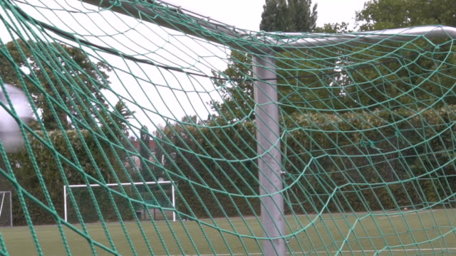 Slow motion of soccer ball into the net