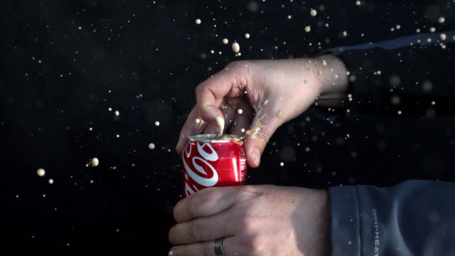 slow motion of soda can opening and spraying as tab is being pulled. - can stock videos & royalty-free footage