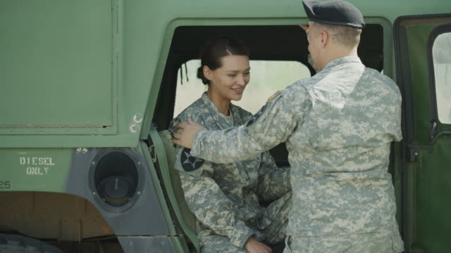vídeos de stock e filmes b-roll de slow motion of soldiers kissing in military vehicle / lehi, utah, united states - lehi