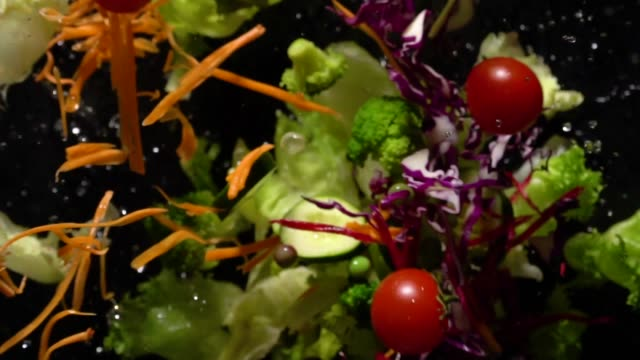 slow motion of splashing salad flying up to camera - salad stock videos & royalty-free footage