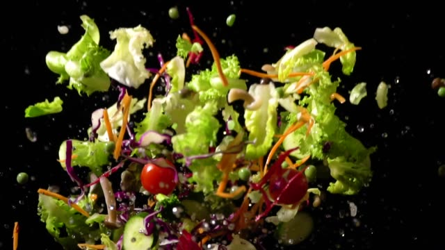 slow motion of splashing salad flying up - salad stock videos & royalty-free footage