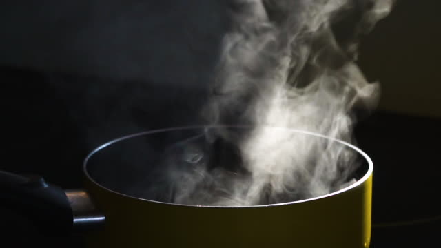 slow motion of steam in cooking pot - steam stock videos & royalty-free footage