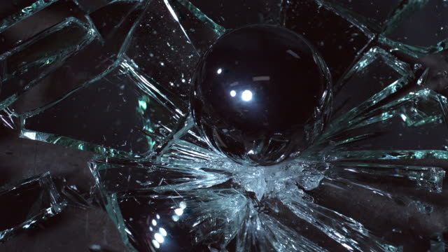 slow motion of steel ball falling on a mirror - mirror stock videos & royalty-free footage