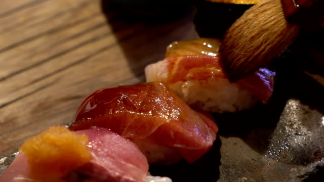 slow motion of sushi cooking - sushi video stock e b–roll