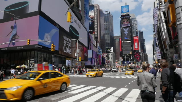 Slow motion of taxi and traffic in New York City Times Square