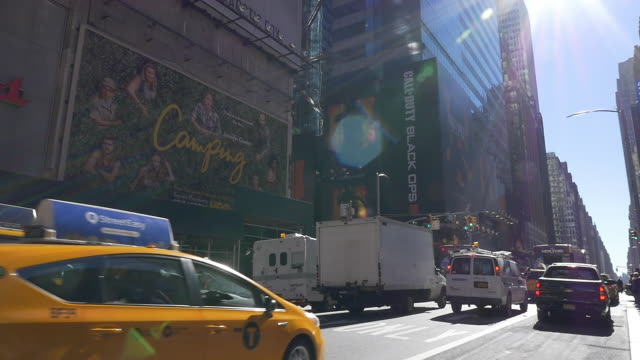 Slow motion of taxi and traffic in Times Square