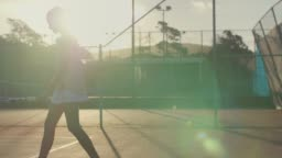 slow motion of tennis player preparing to serve