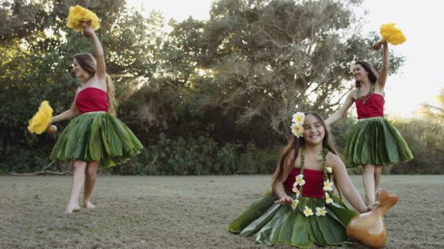slow motion of three hawaiian hula performers - polynesian ethnicity stock videos & royalty-free footage