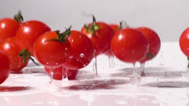 slow motion of tomato drop splashing - cherry tomato stock videos & royalty-free footage