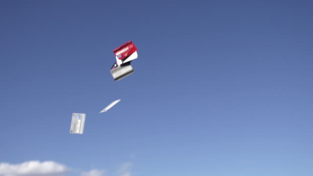 vídeos y material grabado en eventos de stock de slow motion of tossing credit card into sky - lanzar actividad física