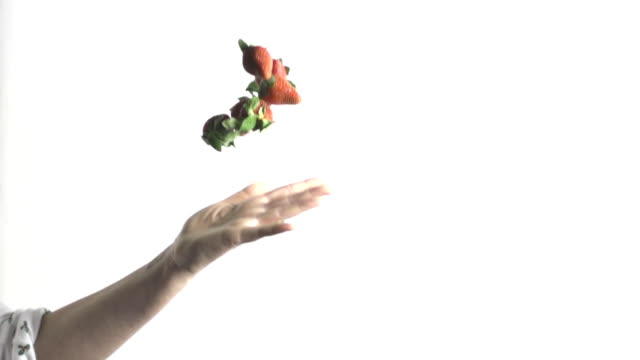 slow motion of tossing fruit strawberry - throwing stock videos & royalty-free footage