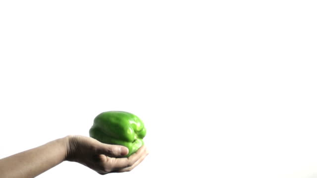slow motion of tossing green pepper - catching stock videos & royalty-free footage
