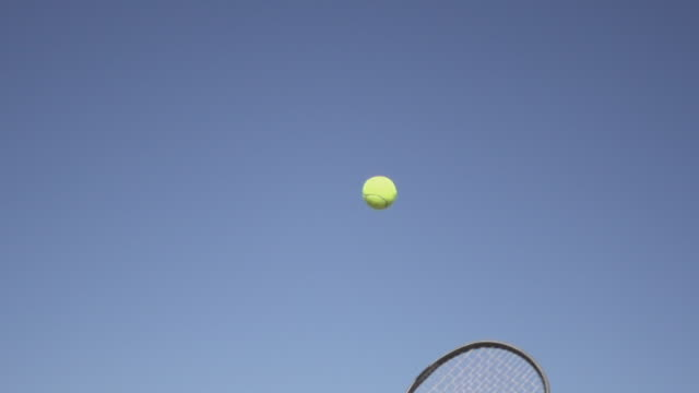 vídeos de stock e filmes b-roll de slow motion of tossing tennis ball and racket - bola de ténis