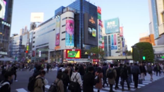 slow motion of tourist pedestrian crowded in shibuya , japan. - shinjuku ward stock videos & royalty-free footage