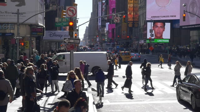 slow motion of tourists walking, police car, disney and mcdonalds signs in times square - disney stock videos & royalty-free footage