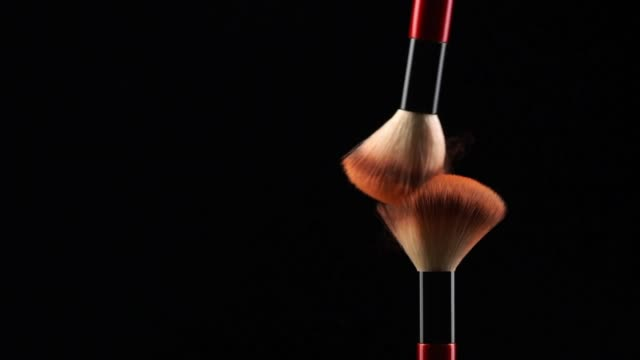 slow motion of two make-up brush spreading. - blusher make up stock videos and b-roll footage