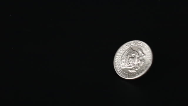 Slow Motion of US Dollar Coin Rotating