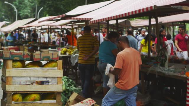 RIO DE JANEIRO, BRAZIL - JUNE 23: Slow motion of vendors in market on June 23, 2013 in Rio, Brazil