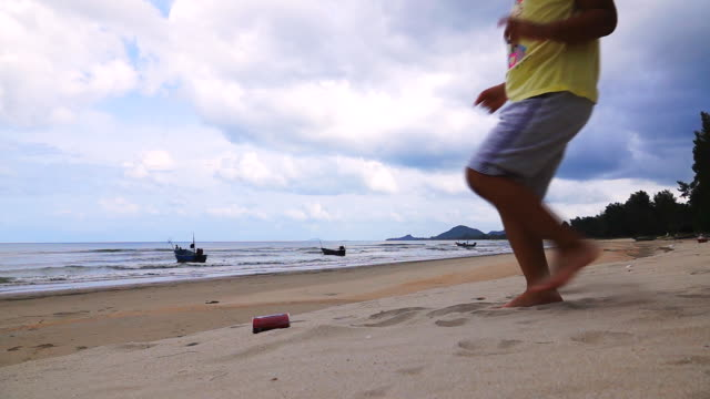 slow motion of waste recycle on the beach, drink cans. - bottle stock videos and b-roll footage