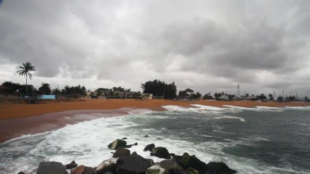 slow motion of waves crashing on rocks/ abidjan/ ivory coast - côte d'ivoire stock videos & royalty-free footage