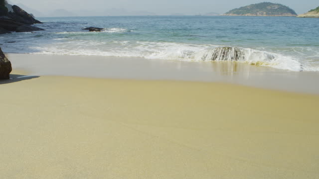 vídeos y material grabado en eventos de stock de slow motion of waves flowing onto red beach in rio. - 2013