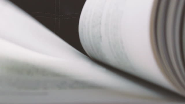 vídeos de stock e filmes b-roll de slow motion of white books pages turning. - livro