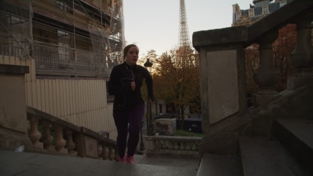 slow motion of woman exercising by running up staircase / paris, ile de france, france - three quarter length stock videos & royalty-free footage
