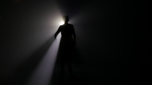 Slow motion of woman walking at night