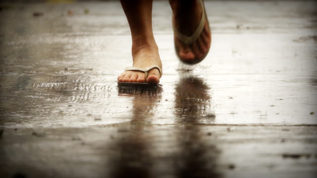 slow motion of woman walking on summer rain - flip flop stock videos and b-roll footage